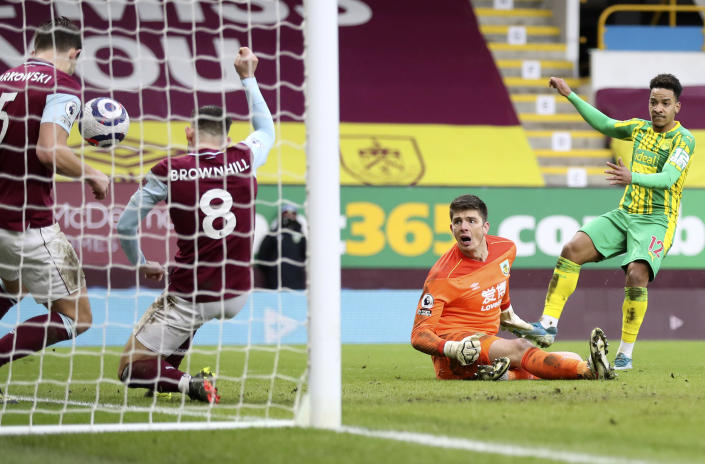Burnley's goalkeeper Nick Pope, 2nd right, watches as his teammates James Tarkowski, left, and Josh Brownhill, 2nd left, deny West Bromwich Albion's Matheus Pereira, right, from scoring during the English Premier League soccer match between Burnley and West Bromwich Albion at Turf Moor stadium in Burnley, England, Saturday, Feb. 20, 2021. (Martin Rickett/Pool via AP)