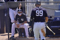 New York Yankees manager Aaron Boone watches as Aaron Judge (99) walks back to the dugout after striking out against Toronto Blue Jays starting pitcher Trent Thornton during the third inning of a spring training exhibition baseball game in Tampa, Fla., Wednesday, March 24, 2021. (AP Photo/Gene J. Puskar)