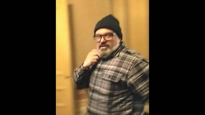 """A federal court affidavit says this video still was Proud Boys member Joseph Biggs as he said, """"This is awesome!"""" while invading the U.S. Capitol on Jan. 6"""