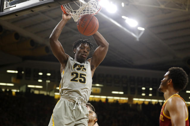 Iowa forward Tyler Cook (25) dunks over Iowa State guard Nick Weiler-Babb during the second half of an NCAA college basketball game, Thursday, Dec. 6, 2018, in Iowa City, Iowa. (AP Photo/Charlie Neibergall)