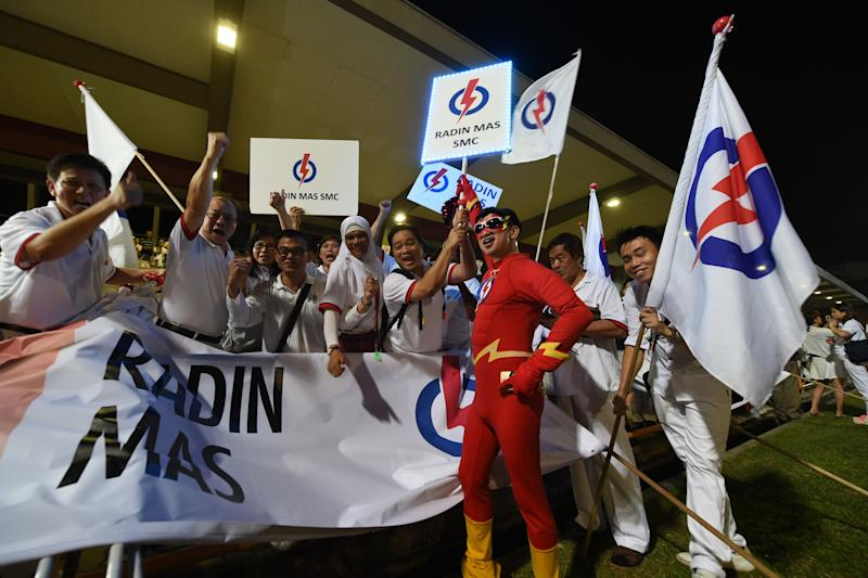 Supporters of the People's Action Party gather at Toa Payoh stadium while waiting for general election results in Singapore on September 11, 2015. Polling stations opened across Singapore on September 11 for a snap election called by Prime Minister Lee Hsien Loong amid an economic slowdown. AFP PHOTO / ROSLAN RAHMAN (Photo credit should read ROSLAN RAHMAN/AFP via Getty Images)