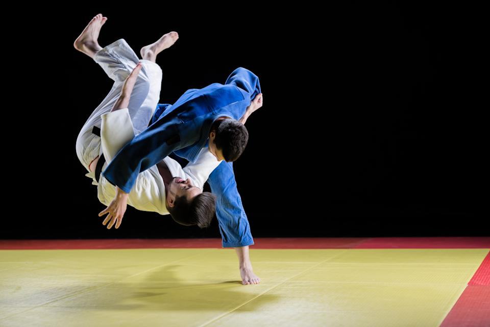 Male Judo Players Competing During Match