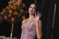 Dua Lipa arrives at the 63rd annual Grammy Awards at the Los Angeles Convention Center on Sunday, March 14, 2021. (Photo by Jordan Strauss/Invision/AP)