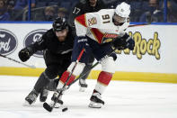 Florida Panthers left wing Anthony Duclair (91) is held up by Tampa Bay Lightning defenseman Erik Cernak (81) during the third period of an NHL hockey game Saturday, April 17, 2021, in Tampa, Fla. (AP Photo/Chris O'Meara)