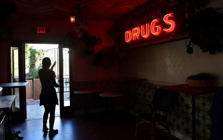 A waitress is silhouetted through a doorway at the Lowell Cafe -- a cannabis restaurant in West Hollywood, California