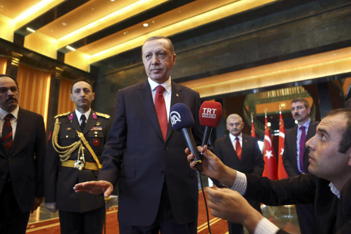 Turkish President Recep Tayyip Erdogan speaks to the press inside the new Ak Saray presidential palace on the outskirts of Ankara on October 29, 2014 (AFP Photo/Adem Altan)