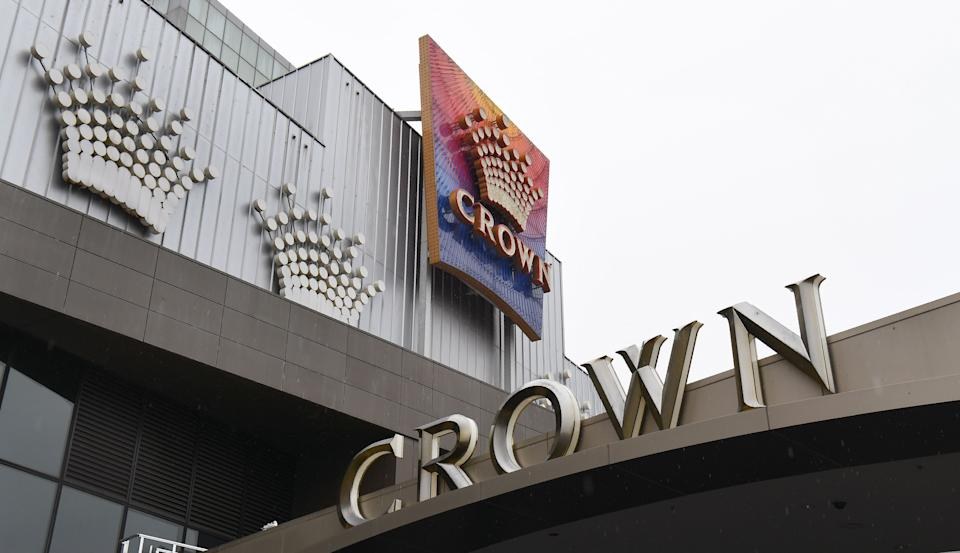 The lights are turned off on Crown Casino signage in Melbourne on August 19, 2020 as its parent company Crown Resorts recorded a full-year net profit fall of 80 percent due to a COVID-19 coronavirus forced closure. (Photo by William WEST / AFP) (Photo by WILLIAM WEST/AFP via Getty Images)