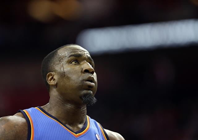 Oklahoma City Thunder's Kendrick Perkins looks up at the scoreboard during the first quarter of an NBA basketball game against the Houston Rockets, Thursday, Jan. 16, 2014, in Houston. (AP Photo/David J. Phillip)