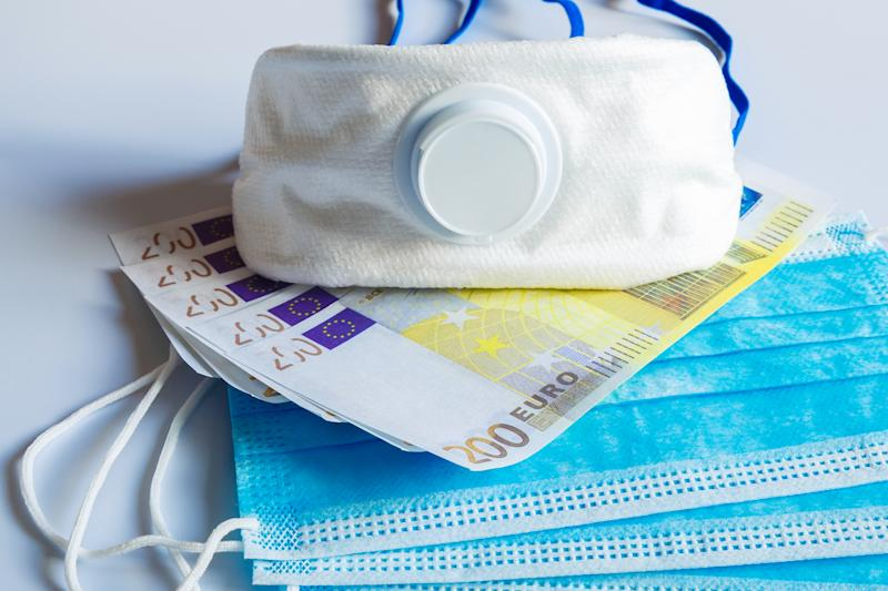 Medical masks and 200 Euro bills as a symbol of increased prices for protecting the respiratory tract from viruses.