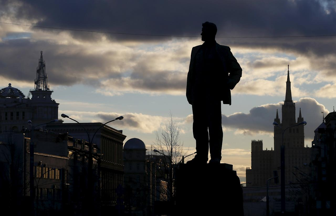 Silhouetted monument of Soviet poet Mayakovsky is pictured at Triumfalnaya Square in Moscow