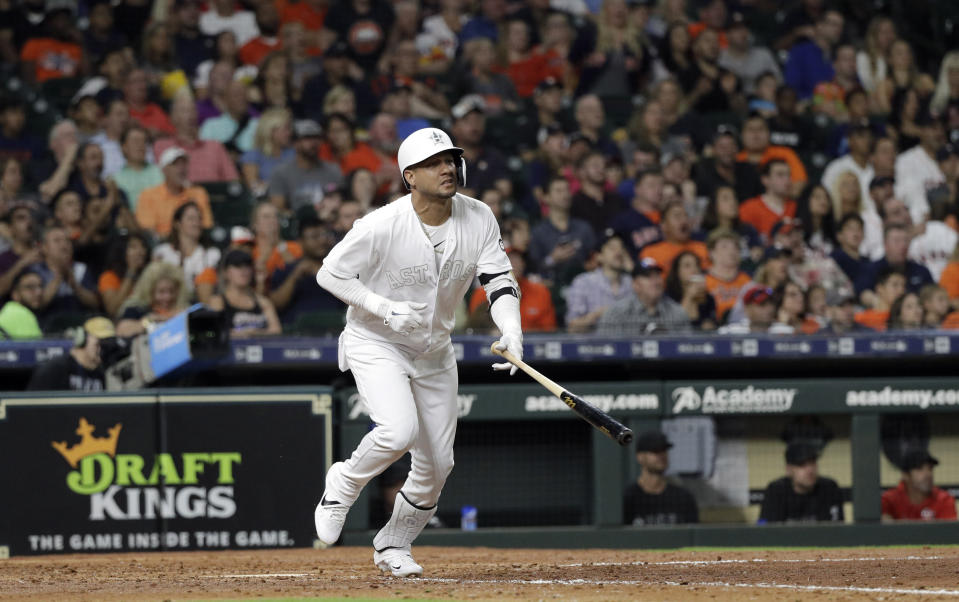 Houston Astros' Yuli Gurriel watches his two-run home run against the Los Angeles Angels during the fifth inning of a baseball game Friday, Aug. 23, 2019, in Houston. (AP Photo/David J. Phillip)