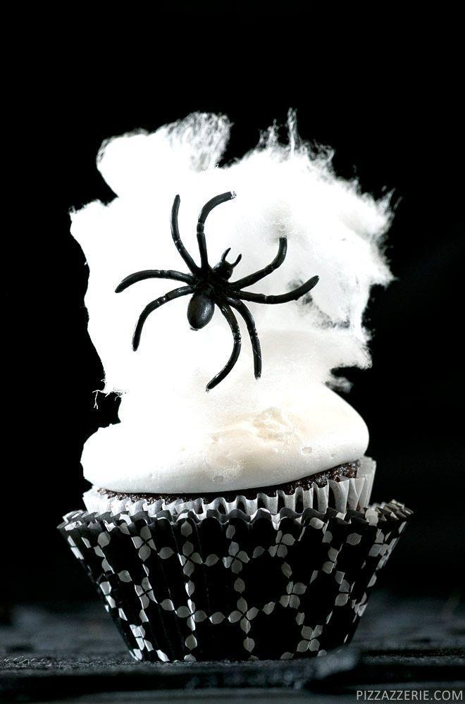 """<p>Top your creation with a pouf of white cotton candy that makes for one sweet spider web.</p><p><strong>Get the recipe at </strong><strong><a href=""""http://pizzazzerie.com/holidays/spider-web-halloween-cupcakes/"""" rel=""""nofollow noopener"""" target=""""_blank"""" data-ylk=""""slk:Pizzazzerie"""" class=""""link rapid-noclick-resp"""">Pizzazzerie</a>.</strong></p><p><strong><strong><strong><a class=""""link rapid-noclick-resp"""" href=""""https://www.amazon.com/Wilton-Non-Stick-Muffin-Cupcake-Baking/dp/B00KIFBI1C/?tag=syn-yahoo-20&ascsubtag=%5Bartid%7C10050.g.1366%5Bsrc%7Cyahoo-us"""" rel=""""nofollow noopener"""" target=""""_blank"""" data-ylk=""""slk:SHOP CUPCAKE TINS"""">SHOP CUPCAKE TINS</a></strong></strong></strong></p>"""