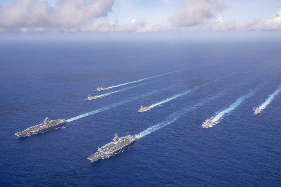 PHILIPPINE SEA (June 23, 2020). The Theodore Roosevelt Carrier Strike Group transits in formation with the Nimitz Carrier Strike Group while conducting dual carrier and airwing operations in the Philippine Sea June 23, 2020. Dual carrier operations unify the tactical power of two individual carrier strike groups, providing fleet commanders with an unmatched, unified credible combat force capable of operating indefinitely. The Nimitz and Theodore Roosevelt carrier strike groups are on scheduled deployments to the Indo-Pacific. (Photo: Mass Communication Specialist Seaman Dylan Lavin/U.S. 7th Fleet)