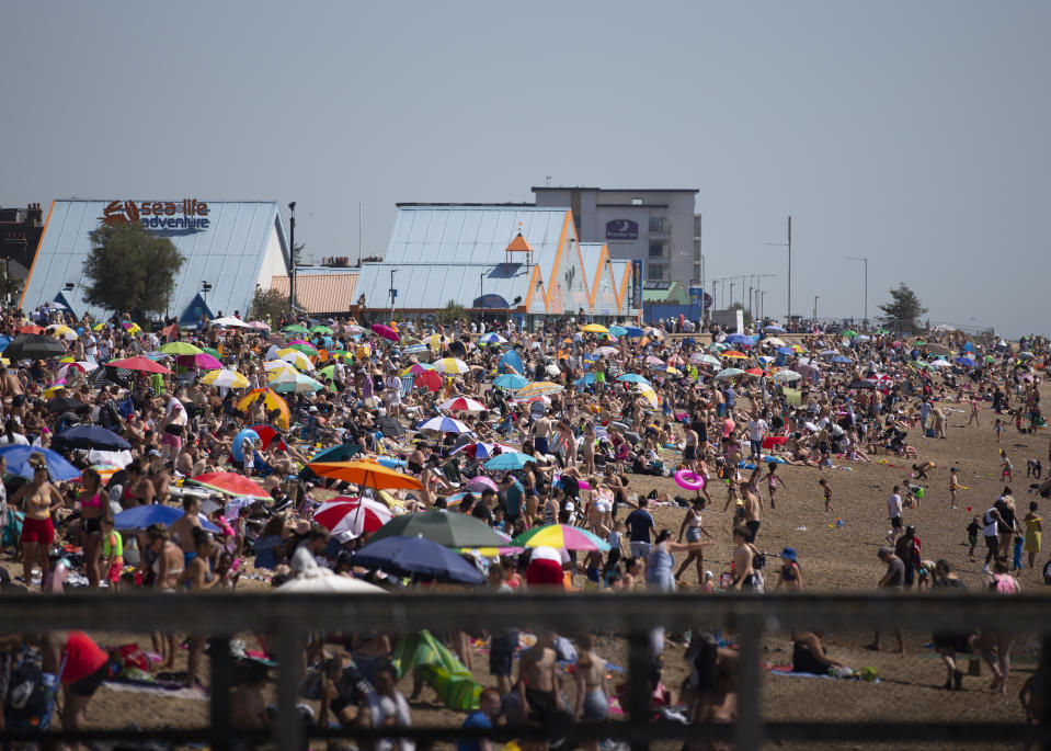 Large crowds gather at Southend beach as temperatures soar to as high as 34 degrees across the UK.