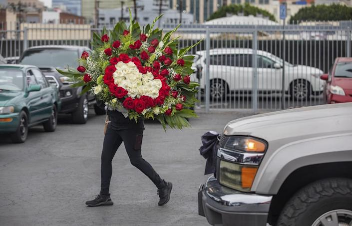 Woman carrying flowers
