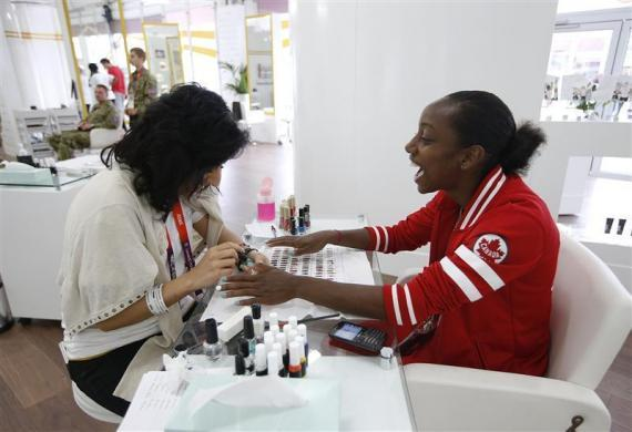 occer player Robyn Gayle of Canada gets her nails done at the athletes village at the Olympic Park in London July 20, 2012.