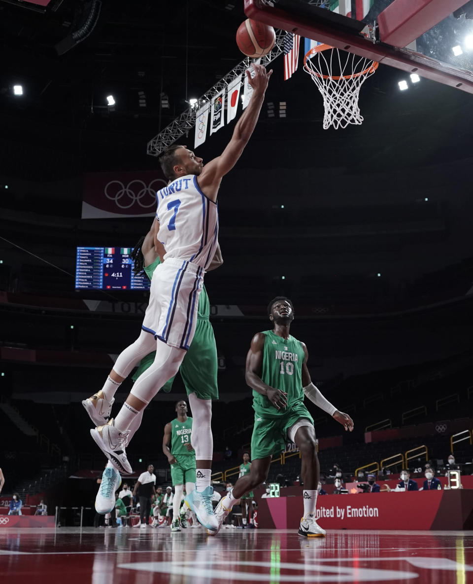 Italy's Stefano Tonut (7), left, scores during men's basketball preliminary round game against Nigeria at the 2020 Summer Olympics, Saturday, July 31, 2021, in Saitama, Japan. (AP Photo/Eric Gay)