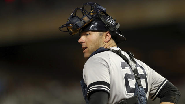 FILE - In this July 24, 2019, file photo, New York Yankees' Austin Romine works behind home plate during a baseball game against the Minnesota Twins in Minneapolis. Romine and the Detroit Tigers finalized a $4.15 million, one-year deal that gives the 31-year-old catcher a chance for a bigger role. (AP Photo/Jim Mone, File)