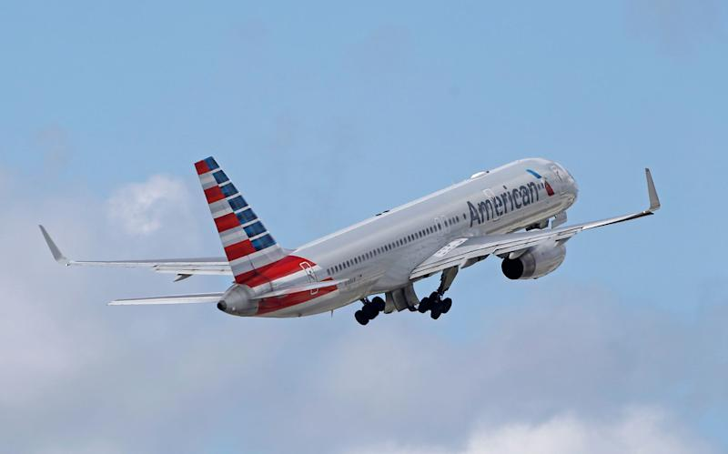 """FILE - In this Friday, June 3, 2016 file photo, an American Airlines passenger jet takes off from Miami International Airport in Miami. American and United have started selling cheaper """"basic economy"""" fares as they battle discount airlines for the most budget-conscious travelers, announced Tuesday, Feb. 21, 2017. (AP Photo/Alan Diaz)"""