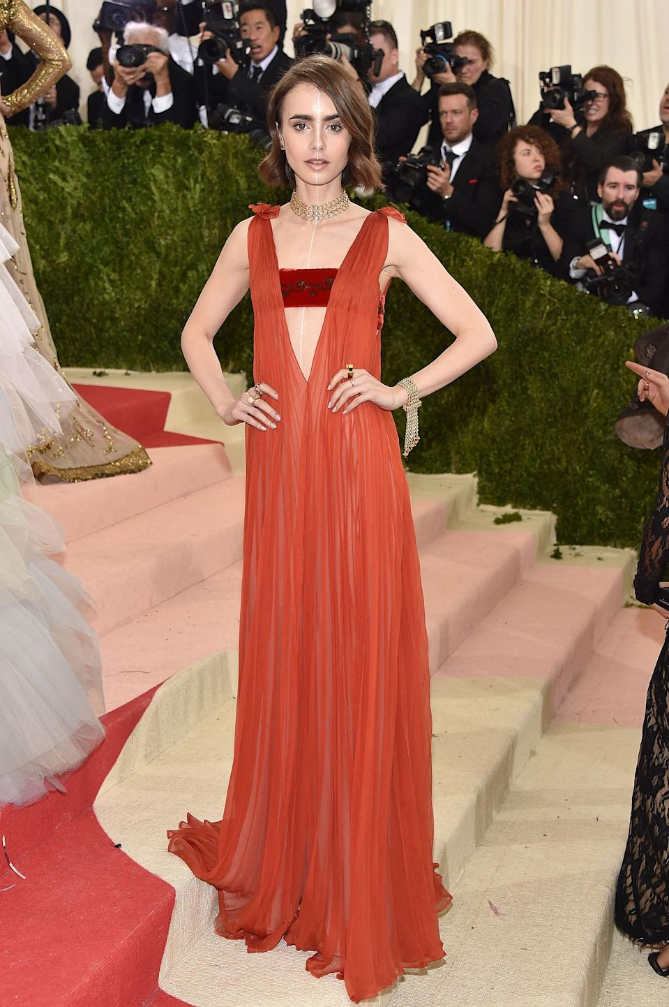 """<h1 class=""""title"""">Lily Collins in a Valentino Dress and Tiffany & Co. jewelry</h1><cite class=""""credit"""">Photo: Getty Images</cite>"""