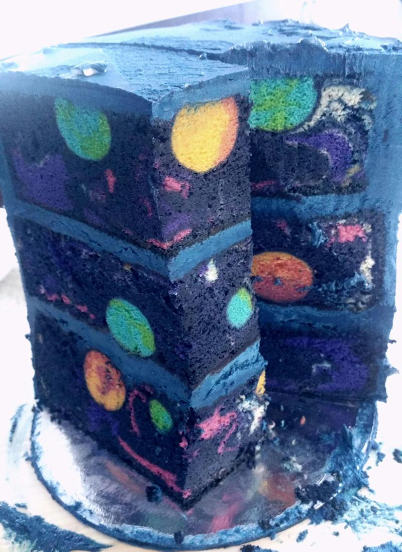Stop what you're doing, there's an actual galaxy inside this birthday cake