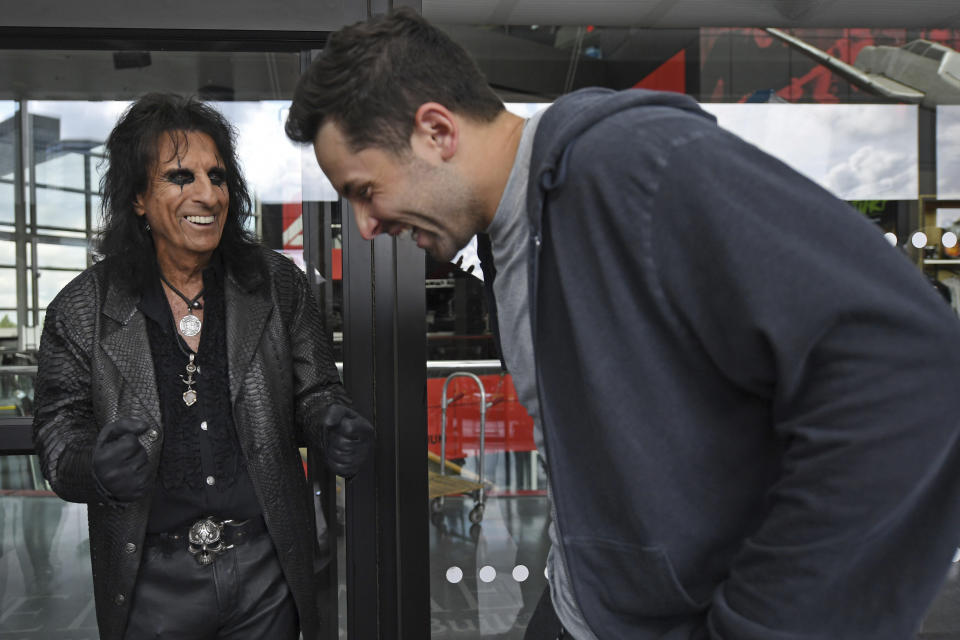 Singer Alice Cooper, left, and Cleveland Browns quarterback Baker Mayfield laugh during a Progressive Insurance commercial shoot at the Rock and Roll Hall of Fame, Thursday, July 22, 2021, in Cleveland. (AP Photo/David Dermer)