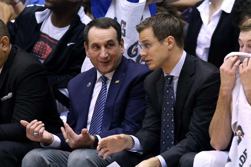30 October 2015: Duke head coach Mike Krzyzewski (left) with assistant Jon Scheyer (right). The Duke University Blue Devils hosted the Florida Southern College Moccasins at Cameron Indoor Stadium in Durham, North Carolina in a 2015-16 NCAA Men's Basketball Exhibition game. Duke won the game 112-68. (Photograph by Andy Mead/YCJ/Icon Sportswire) (Photo by Andy Mead/YCJ/Icon Sportswire/Corbis/Icon Sportswire via Getty Images)