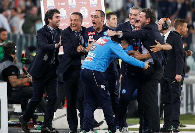 Soccer Football - Serie A - Juventus v Napoli - Allianz Stadium, Turin, Italy - April 22, 2018 Napoli coach Maurizio Sarri celebrates after the match with his coaching staff REUTERS/Stefano Rellandini