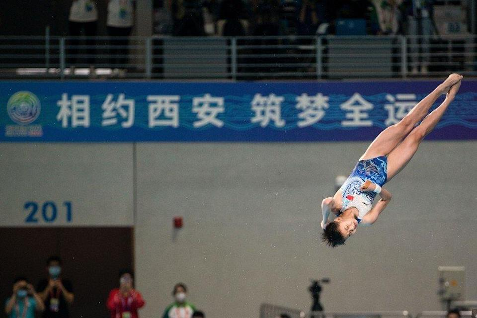 Quan Hongchan of Guangdong competes in the Women's 10m platform diving event during the 14th National Games of China on September 6, 2021. Photo: Getty Images