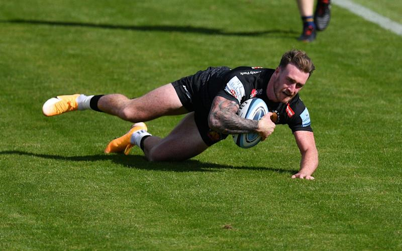 Stuart Hogg of Exeter Chiefs dives over to score a try during the Gallagher Premiership Rugby match between Exeter Chiefs and Worcester Warriors at Sandy Park on August 30 -Stuart Hogg interview: 'I am loving life at Exeter - it is the happiest I've been in a long time' - GETTY IMAGES