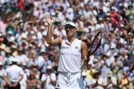Tennis - Wimbledon - All England Lawn Tennis and Croquet Club, London, Britain - July 12, 2018 Germany's Angelique Kerber celebrates winning her semi final match against Latvia's Jelena Ostapenko Jonathan Brady/Pool via Reuters