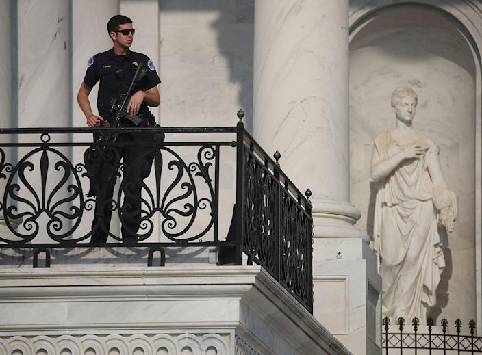 <p>A U.S. Capitol Police officer stands guard in front of the U.S. Capitol Building, on June 14, 2017 in Washington. (Photo: Mark Wilson/Getty Images) </p>