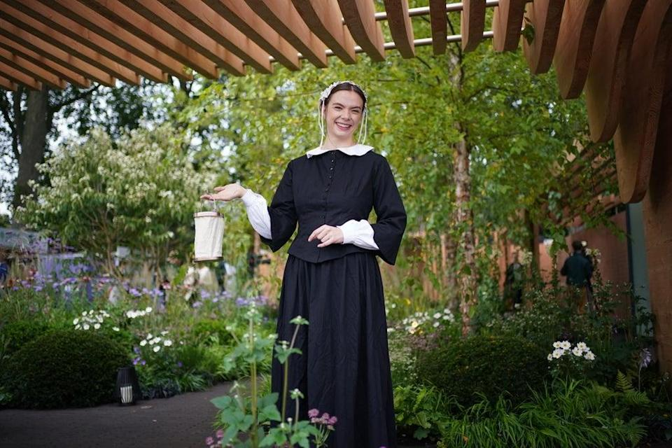 A woman dressed as Florence Nightingale in the Florence Nightingale garden at the RHS Chelsea Flower Show (Yui Mok/PA) (PA Wire)