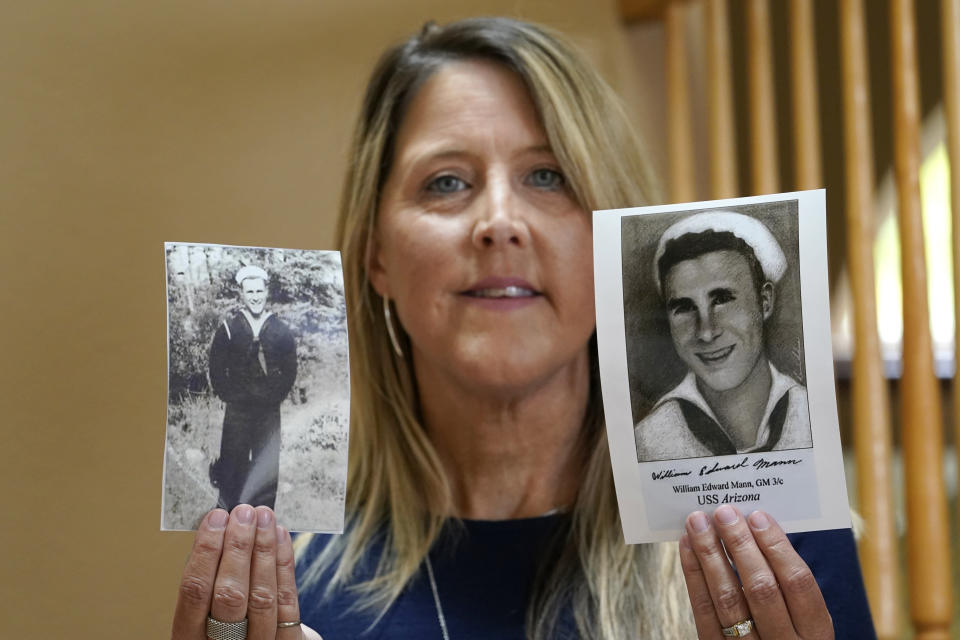 Teri Mann Whyatt displays photos of her uncle, William Edward Mann, who died on the USS Arizona during the bombing of Pearl Harbor, at her home Wednesday, July 14, 2021, in Newcastle, Wash. In recent years, the U.S. military has taken advantage of advances in DNA technology to identify the remains of hundreds of sailors and Marines who died in the 1941 bombing of Pearl Harbor and has sent them home to their families across the country for burial. The remains of 85 unknowns from the USS Arizona, which lost more men during the attack than any other ship, haven't received this treatment, however. (AP Photo/Elaine Thompson)