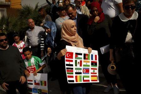 People take part in a protest in rejection to the Paris and Mali attacks and the attacks worldwide, called by the Islamic Association Al-Balsam in Arroyo de la Miel, near Malaga, southern Spain, November 21, 2015. REUTERS/Jon Nazca