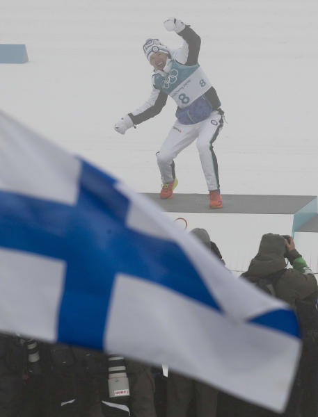 Iivo Niskanen, of Finland, celebrates after winning the gold medal in the men's 50k cross-country skiing competition at the 2018 Winter Olympics in Pyeongchang, South Korea, Saturday, Feb. 24, 2018. (AP Photo/Dmitri Lovetsky)