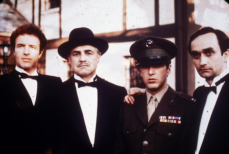 1972: Left to right: American actors James Caan, Marlon Brando, Al Pacino and John Cazale (1936 - 1978) pose together outdoors in a still from director Francis Ford Coppola's film, 'The Godfather,' based on the novel by Mario Puzo. (Photo by Paramount Pictures/Fotos International/Getty Images)