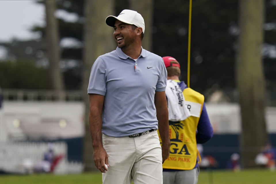 Jason Day of Australia, smiles has he walks off on the ninth green during the first round of the PGA Championship golf tournament at TPC Harding Park Thursday, Aug. 6, 2020, in San Francisco. (AP Photo/Jeff Chiu)