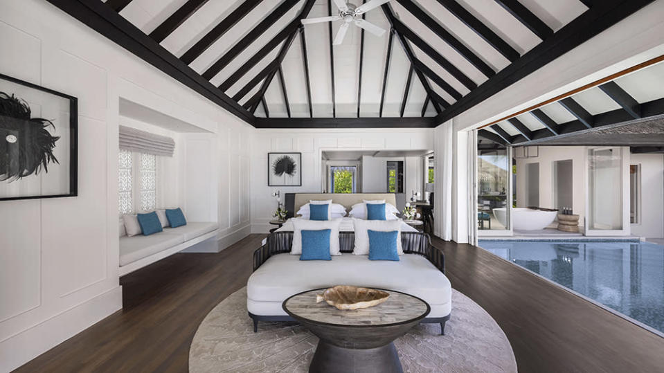 One of the spacious bedrooms with an open-air design and a swimming pool.  - Credit: Victor Romero