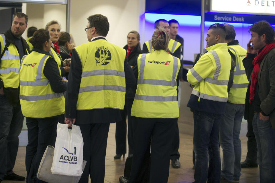 Strikong employees stand around on the second day of a strike of Swissport ground and cargo service at Brussels national airport in Zaventem,on May 14, 2013. AFP PHOTO/ NICOLAS MAETERLINCK        (Photo credit should read NICOLAS MAETERLINCK/AFP via Getty Images)