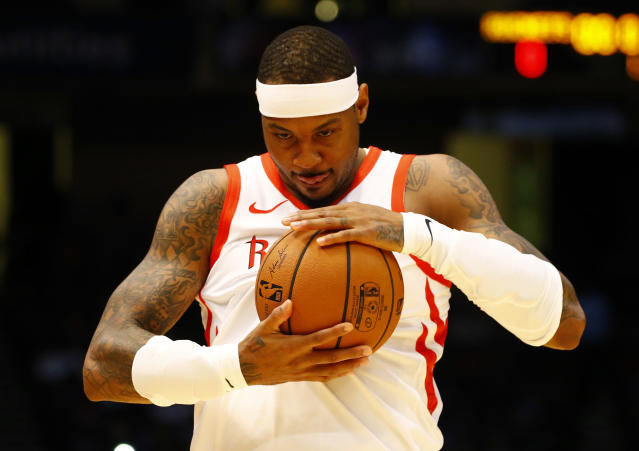 Carmelo Anthony and the Rockets haven't broken up yet, but the player is already looking for a couch to crash on.. (AP Photo)