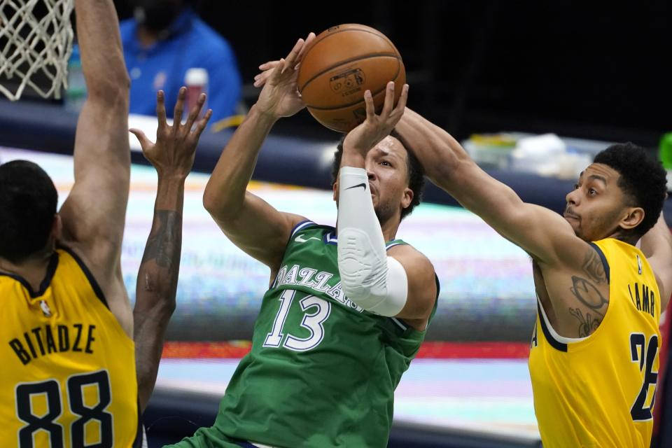 Indiana Pacers center Goga Bitadze (88) and guard Jeremy Lamb (26) defend against a shot by Dallas Mavericks guard Jalen Brunson (13) during the first half of an NBA basketball game in Dallas, Friday, March 26, 2021. (AP Photo/Tony Gutierrez)