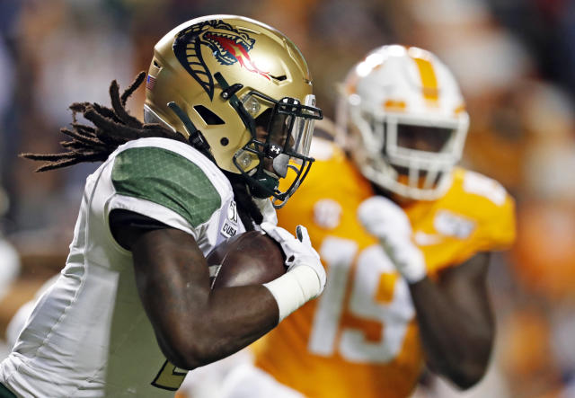 UAB running back Lucious Stanley (2) runs for yardages as he's chased by Tennessee linebacker Darrell Taylor (19) in the first half of an NCAA college football game, Saturday, Nov. 2, 2019, in Knoxville, Tenn. (AP Photo/Wade Payne)
