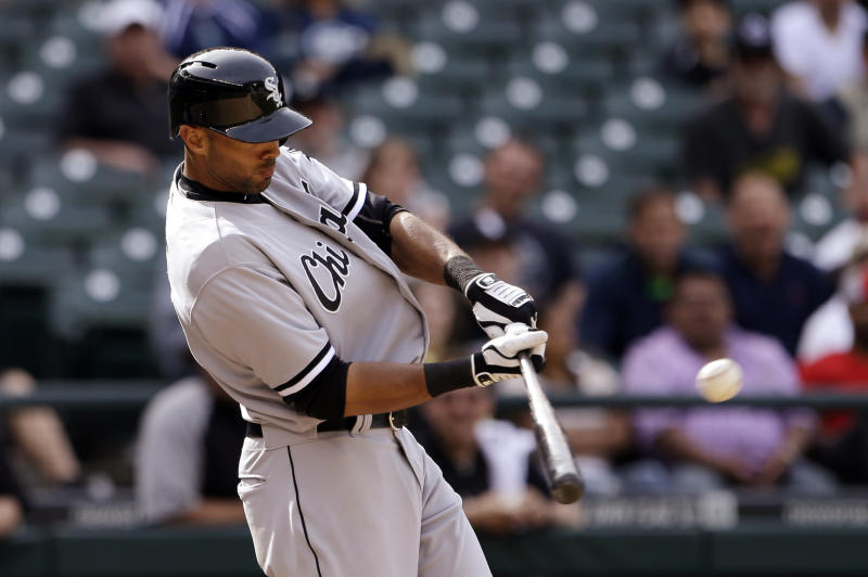 Chicago White Sox's Alex Rios singles in the first two runs of the baseball game against the Seattle Mariners in the 14th inning on Wednesday, June 5, 2013, in Seattle. (AP Photo/Elaine Thompson)