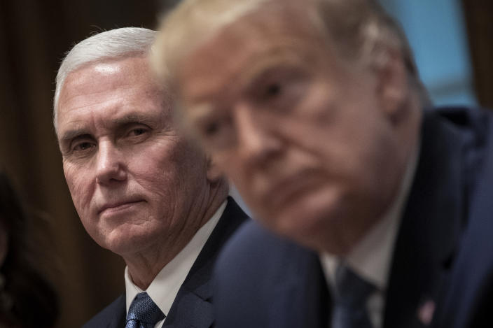 (L-R) U.S. Vice President Mike Pence and U.S. President Donald Trump listen during a meeting about the Governors Initiative on Regulatory Innovation in the Cabinet Room of the White House on December 16, 2019 in Washington, DC. (Drew Angerer/Getty Images)