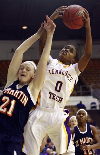 Tennessee Tech guard Diamond Henderson (0) grabs a rebound over Tennessee Martin forward Sydney Vanlandingham (21) in the first half of the championship game in the Ohio Valley Conference NCAA college basketball tournament on Saturday, March 9, 2013, in Nashville, Tenn. (AP Photo/Wade Payne)