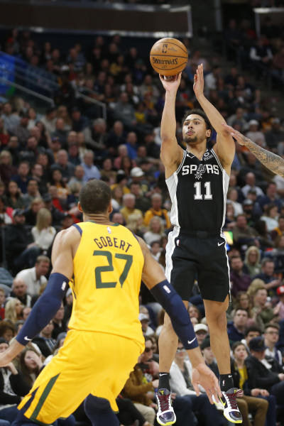 San Antonio Spurs guard Bryn Forbes (11) shoots as Utah Jazz center Rudy Gobert (27) defends during the first half of an NBA basketball game Friday, Feb. 21, 2020, in Salt Lake City. (AP Photo/Rick Bowmer)