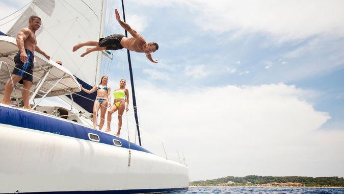 man jumping off boat into water