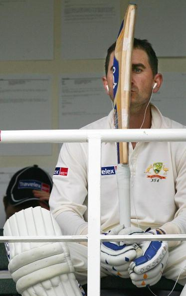 LONDON - SEPTEMBER 09: Not out batsman Justin Langer of Australia listens to music outside the dressing room during a delay caused by bad light during day two of the Fifth npower Ashes Test between England and Australia played at The Brit Oval on September 9, 2005 in London, United Kingdom (Photo by Hamish Blair/Getty Images)