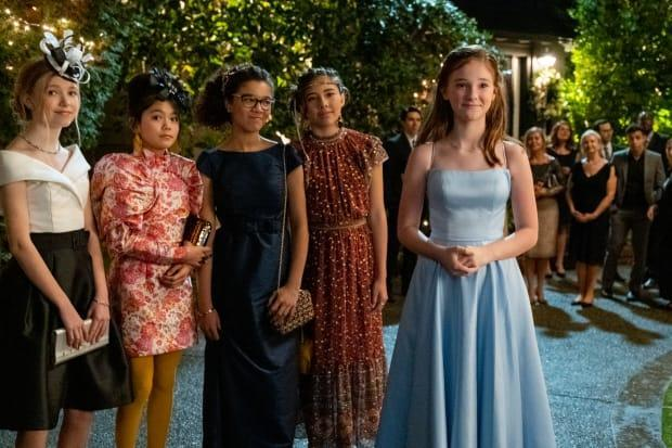 (L–R): Stacey, in a customized Tarik Ediz for top of the dress, combined with a Simons dress for the skirting, Claudia in Rotate by Birger Christensen, Mary Anne in vintage Alfred Sung, Dawn in Ulla Johnson and Kristy in customized Sherri Hill.